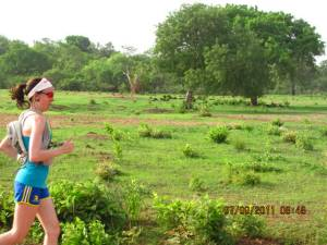 a female Canadian runner runs across The Gambia in Africa