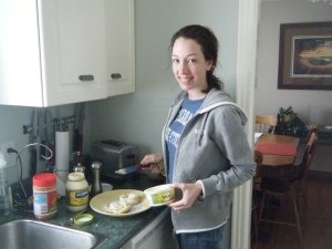Marathoner adding butter to high calorie lunch
