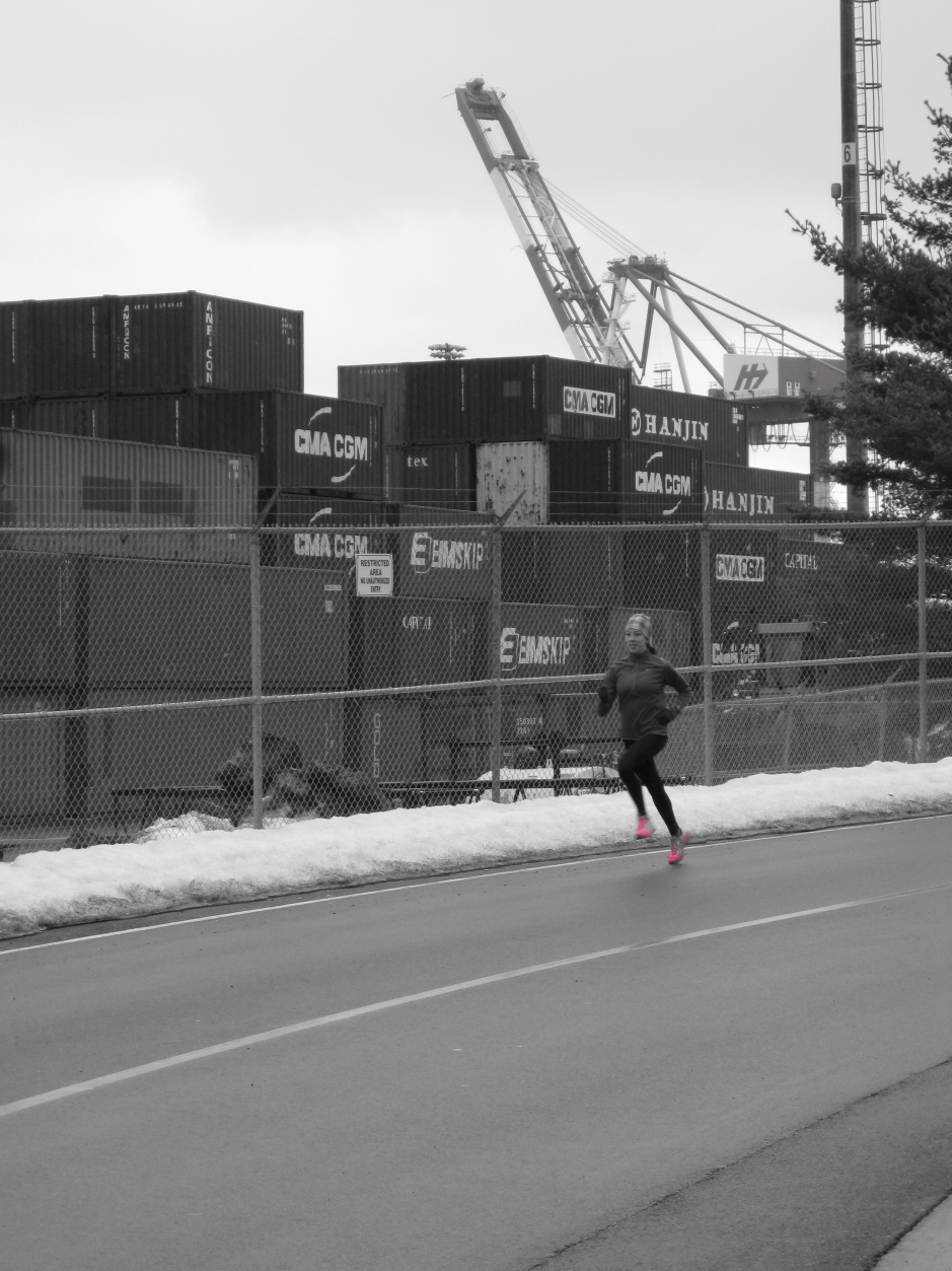 Runner at Halifax Seaport wearing ASICS Speedstars