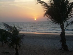 sun sets on Fajara Beach, The Gambia