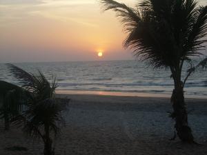 sun sets on Fajara Beach, The Gambia