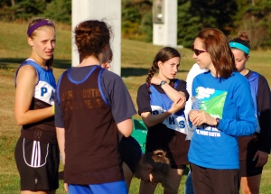 high school cross country coach talks to her athletes