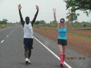 A Canadian and a Gambia runner celebrate