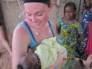 A Canadian nurse and a newborn in The Gambia, Africa