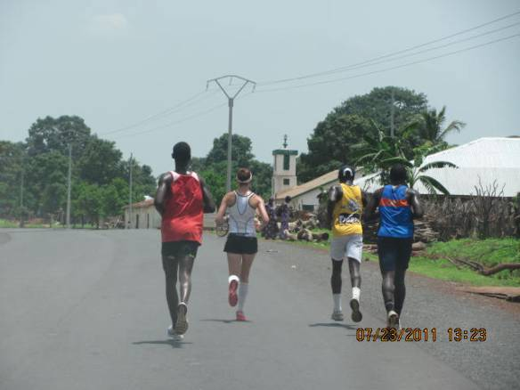 4 teammates run together across The Gambia, Africa