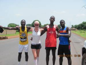 3 Gambian runners and 1 Canadian runner running together