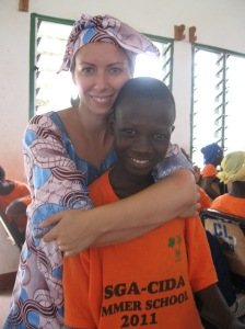 a canadian health volunteer and a Gambian student in Africa