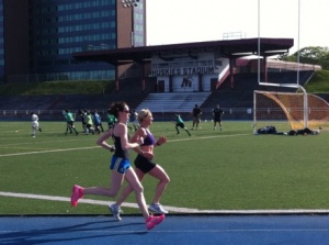 two runners train at SMU track