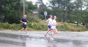 3 runners running Rum Runners Relay