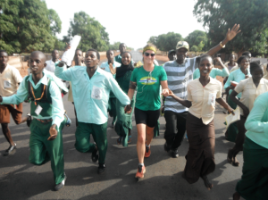 Holding hands with peer health educators while running through town