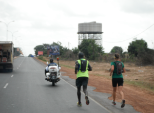 Kebba and I running with the police escort